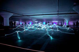 Netwerk van licht in een parkeergarage in Toronto. Photo by Marius Masalar on Unsplash